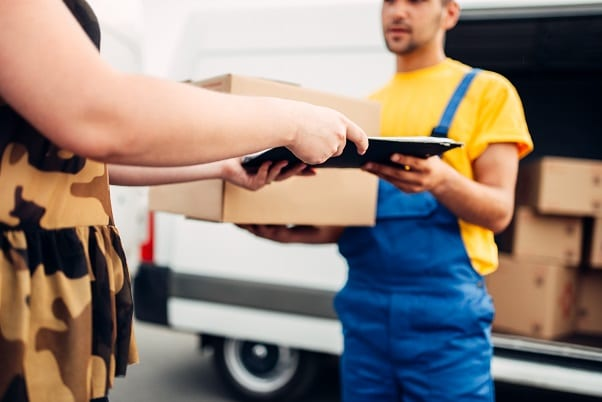 Prevent porch pirates from stealing your Christmas Presents Cargo delivery, courier gives parcel to the client